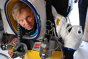 "Watch Google exec Alan Eustace break freefall record with 135,000 foot jump from outer space <br /> <br /> He broke the sound barrier and hit a top speed of 822mph during his four-and-a-half minute descent to Earth    <br /> This is the moment a Google executive broke the sound barrier and set a new freefall record with a 135,000 foot jump from space.<br /> <br /> Wearing a specially-designed spacesuit which took three years to develop, Alan Eustace made his ascent via a high-altitude, helium-filled balloon just as the sun was rising.<br /> <br /> He then separated himself from the balloon and started to plummet back to Earth.<br /> <br /> Eustace - who smashed the record previously held by daredevil Felix Baumgartner - hit a top velocity of 822mph during a freefall that lasted four and a half minutes before landing in the southern New Mexico desert.<br /> <br /> Jim Hayhurst, director of competition at the United States Parachute Association, the jump's official observer, said Eustace used a drogue parachute that gave him incredible stability and control despite the massive Mach 1.23 speed reached during the freefall.<br /> <br /> Mr Eustace - who has 25 years experience as a pilot - said he did not feel it when he broke the sound barrier, but the ground crew heard the resulting sonic boom.<br /> <br /> ""He just said it was a fabulous view. He was thrilled,"" said Mr Hayhurst of his conversation with Eustace after he landed.<br /> <br /> The supersonic jump was part of a project by Paragon Space Development and its Stratospheric Explorer team, which has been working secretly for years to develop a self-contained commercial spacesuit that would allow people to explore about 20 miles above the Earth's surface.<br /> <br /> Mr Eustace's success marks a major step forward.<br /> <br /> ""This has opened up endless possibilities for humans to explore previously seldom visited parts of our stratosphere,"" said Grant Anderson, Paragon's president and CEO.<br /> <br /> The technology that has gone into developing the balloon, the spacesuit and the other systems that were used in the launch will be used to advan"