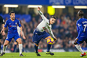 Tottenham Hotspur midfielder Erik Lamela (11) under pressure from Chelsea midfielder Ngolo Kante (7) during the Premier League match between Chelsea and Tottenham Hotspur at Stamford Bridge, London, England on 27 February 2019.