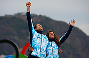 The oldest medal winner of the Rio 2016 Olympic Games 54 year old lung cancer survivor Santiago Lange (L) and Cecilia Carranza Saroli (R) from Argentina react to receiving Gold during the awards ceremony in the Nacra 17 Mixed class of the Rio 2016 Olympic Games Sailing events in Rio de Janeiro, Brazil, 16 August 2016.