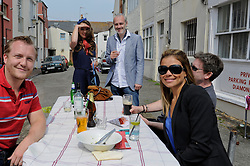 Brighton, UK. 29/04/2011. The Royal Wedding of HRH Prince William to Kate Middleton. People in Gloucester Road celebrate the Royal Wedding at a street party. Photo credit should read: Peter Webb/LNP. Please see special instructions for licensing information. © under license to London News Pictures