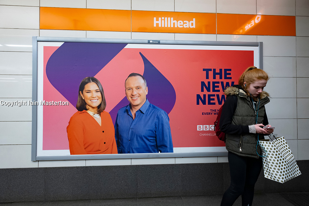 Billboard advertising new BBC Scotland TV channel evening news show The Nine and presenters Rebecca Curran and Martin Geissler, inside station on the Glasgow Subway system, Glasgow, Scotland, UK