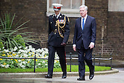 Photographer: Rick Findler<br /> <br /> London UK. 08.05.15 Secretary of State for Defence Michael Fallon MP (right) walks into 10 Downing Street to meet with the Prime Minister David Cameron. Cameron appeared triumphant today as he was the doctor in becoming the new Prime Minster in the 2015 general election.