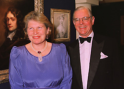 MR & MRS ANTHONY SPINK he is the leading art dealer, at a reception in London on 11th June 1998.MIG 5