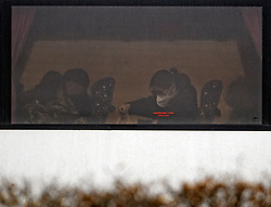 © Licensed to London News Pictures. 09/02/2020. Milton Keynes, UK. Passengers evacuated from Wuhan in China are seen wearing masks on a bus as they arrive at a facility in Milton Keynes, Buckinghamshire. Around 150 Britons on the most recent UK government flight back from the centre of the coronavirus outbreak in China are being housed at Kents Hill Park Conference Centre in Milton Keynes for a 14-day quarantine. Photo credit: Ben Cawthra/LNP
