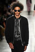 Brandon Bailey walks the runway wearing Custo Barcelona Fall 2016 20th Anniversary Collection during New York Fashion Week on February 14, 2016