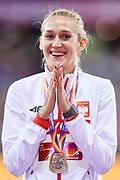 Great Britain, London - 2017 August 12: Kamila Licwinko (Podlasie Bialystok) of Poland celebrates bronze medal in women&rsquo;s high jump while awarding ceremony during IAAF World Championships London 2017 Day 9 at London Stadium on August 12, 2017 in London, Great Britain.<br /> <br /> Mandatory credit:<br /> Photo by &copy; Adam Nurkiewicz<br /> <br /> Adam Nurkiewicz declares that he has no rights to the image of people at the photographs of his authorship.<br /> <br /> Picture also available in RAW (NEF) or TIFF format on special request.<br /> <br /> Any editorial, commercial or promotional use requires written permission from the author of image.
