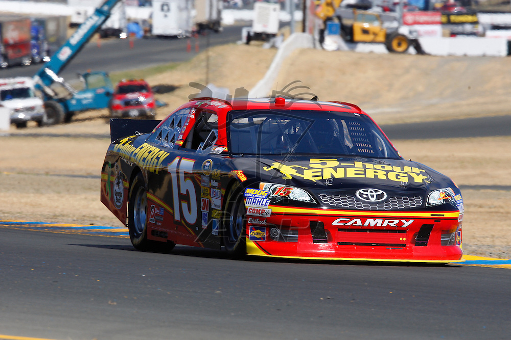 SONOMA, CA - JUN 23, 2012:  Clint Bowyer (15) brings his car through turn 10 during a practice session for the Toyota Save Mart 350 at the Raceway at Sonoma in Sonoma, CA.