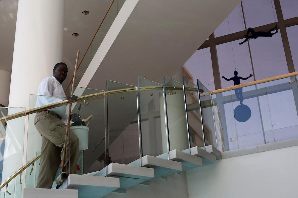 "A sudanese refugee makes his to do his duties in the Royal Beach Hotel on February 28 2011. The municipality hung 1,500 red flags around the city as a sign of warning and put up hundreds of banners reading: ""Protecting our home, the residents of Eilat are drawing the line on infiltration."" Eilat Mayor Meir Yitzhak Halevi said that 10 percent of the city's population was currently made up of migrants and that the residents feel that the city has been conquered...Photo by Olivier Fitoussi."