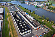 Nederland, Zuid-Holland, Ridderkerk, 23-05-2011; Noord en Nieuwe Maas. Boon distibutiecentrum in de vorm van oceaanstomer. Distribution center, building in the form of ocean steamer...luchtfoto (toeslag), aerial photo (additional fee required).copyright foto/photo Siebe Swart