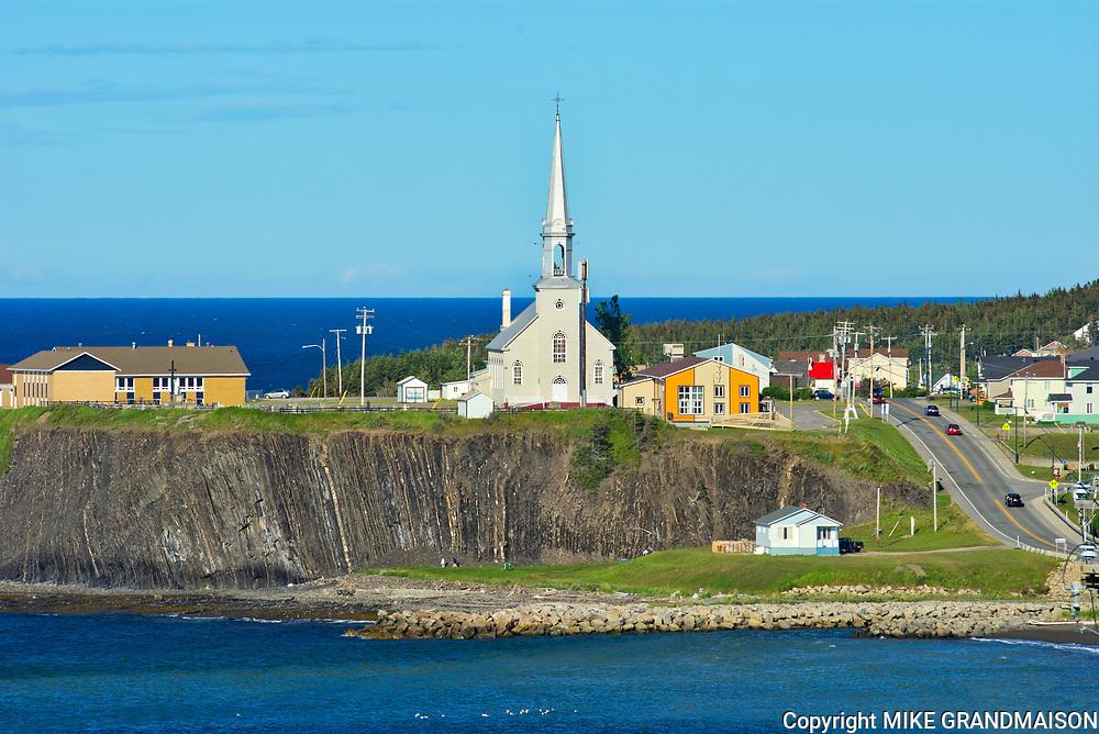 Coastal village of Grande Vallée with church<br />Grande Vallée<br />Quebec<br />Canada