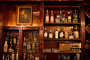 A portrait of John F. Kennedy and his wife Jacqueline hangs behind the bar amongst various liquor bottles at the Kennedy Room on Friday, January 18, 2013 in Dallas, Tx. (Cooper Neill/The Dallas Morning News)