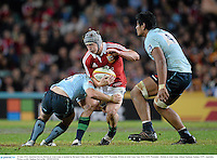 15 June 2013; Jonathan Davies, British & Irish Lions, is tackled by Bernard Foley, left, and Will Skelton, NSW Waratahs. British & Irish Lions Tour 2013, NSW Waratahs v British & Irish Lions, Allianz Stadium, Sydney, NSW, Australia. Picture credit: Stephen McCarthy / SPORTSFILE