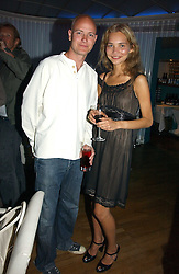 The HON.JUSTIN PORTMAN and DIANA KAMALOVA at a party to celebrate the publication of 'How to Party' by Yasmin Mills with illustrations by Olympia Scarry, held at the Fifth Floor Restaurant, Harvey Nichols, Knightsbridge, London on 3rd July 2006.<br /><br />NON EXCLUSIVE - WORLD RIGHTS