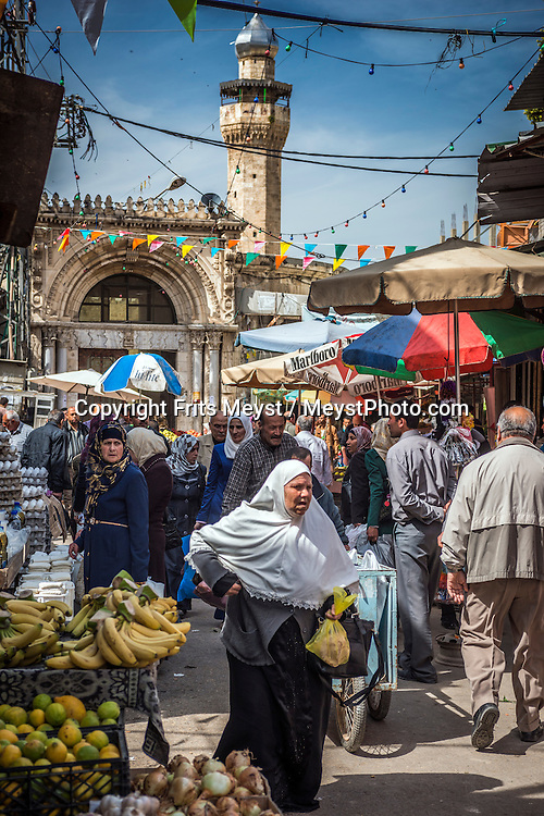 Nablus, Palestine, March 2015. The busy streets around the souk in the old town of Nablus. The Abraham Path is a long-distance walking trail across the Middle East which connects the sites visited by the patriarch Abraham. The trail passes through sites of Abrahamic history, varied landscapes, and a myriad of communities of different faiths and cultures, which reflect the rich diversity of the Middle East. Photo by Frits Meyst / MeystPhoto.com for AbrahamPath.org