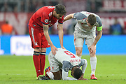 Liverpool midfielder Georginio Wijnaldum (5) on the ground after a foul by Bayern Munich midfielder Thiago Alcantara (6) (not in picture) during the Champions League match between Bayern Munich and Liverpool at the Allianz Arena, Munich, Germany, on 13 March 2019.