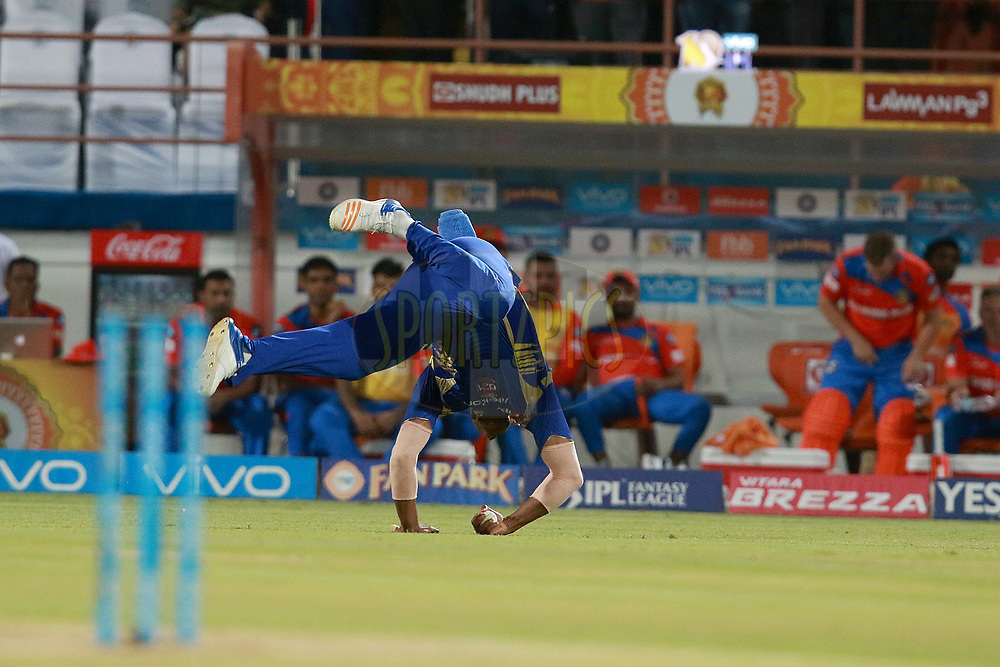 Kieron Pollard of MI takes a catch of Suresh Raina captain of GL during match 35 of the Vivo 2017 Indian Premier League between the Gujarat Lions and the Mumbai Indians  held at the Saurashtra Cricket Association Stadium in Rajkot, India on the 29th April 2017<br /> <br /> Photo by Rahul Gulati - Sportzpics - IPL