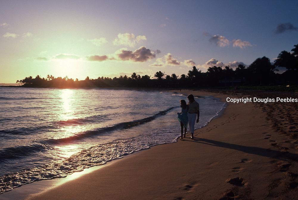 Couple at sunset, Poipu Beach, Kauai<br />