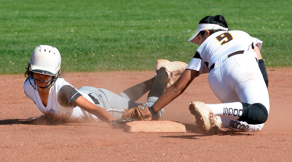 gbs040617j/SPORTS -- Volcano Vista's Jaden Encinas slides safely into second bases avoiding the tag of Cibola's Amanda Moreno, 9, in the first inning of the game against Volcano Vista on Thursday, April 6, 2017. (Greg Sorber/Albuquerque Journal)
