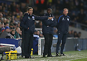 Brighton Manager, Chris Hughton, Queens Park Rangers manager Jimmy Floyd Hasselbaink during the Sky Bet Championship match between Queens Park Rangers and Brighton and Hove Albion at the Loftus Road Stadium, London, England on 15 December 2015.