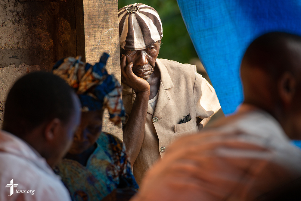 A man waits for his prescription on the second day of the LCMS Mercy Medical Team on Tuesday, May 8, 2018, in the Yardu village outside Koidu, Sierra Leone, West Africa. The blue tarp helped keep the sun from the pharmacy area. LCMS Communications/Erik M. Lunsford