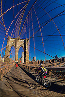 Pedestrians walking over Brooklyn Bridge to Manhattan, New York, New York USA.