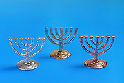 Miniature Menorah on Blue Background