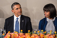 First Lady Michelle Obama looks at President Barack Obama as they sit down for the Inaugural Luncheon  in Statuary Hall in the U.S. Capitol on Monday, January 21, 2013 in Washington, DC.