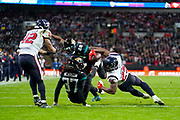 Houston Texans Running Back Duke Johnson (25) stretches over the line for a touchdown during the International Series match between Jacksonville Jaguars and Houston Texans at Wembley Stadium, London, England on 3 November 2019.