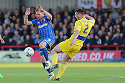 Dannie Bulman midfielder of AFC Wimbledon (4) and Matty Pearson defender Accrington Stanley (2) during  the Sky Bet League 2 Play-Off first leg match between AFC Wimbledon and Accrington Stanley at the Cherry Red Records Stadium, Kingston, England on 14 May 2016. Photo by Stuart Butcher.
