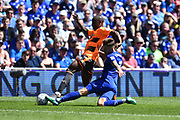 Sone Aluko (14) of Reading is tackled by Joe Bennett (3) of Cardiff City during the EFL Sky Bet Championship match between Cardiff City and Reading at the Cardiff City Stadium, Cardiff, Wales on 6 May 2018. Picture by Graham Hunt.