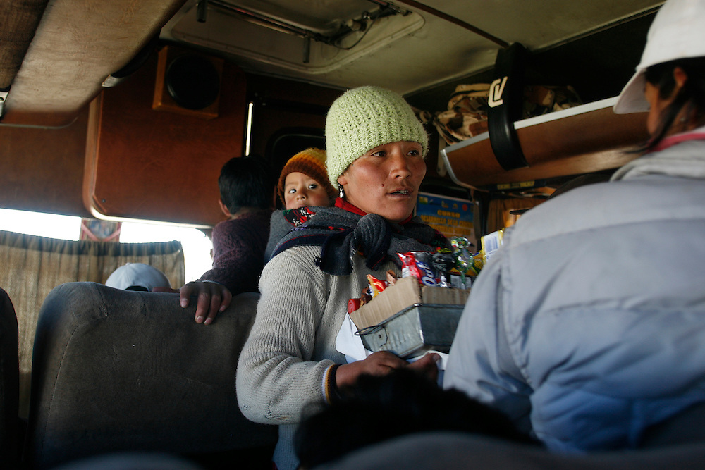 An indigenous woman sells candy and treats to passengers riding on a bus from Rumichaca to Huancavelica, Peru, Thursday, May 15, 2008.