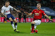 Manchester United defender Luke Shaw (23) late to block a cross from Tottenham Hotspur defender Kieran Trippier (2) during the Premier League match between Tottenham Hotspur and Manchester United at Wembley Stadium, London, England on 13 January 2019.