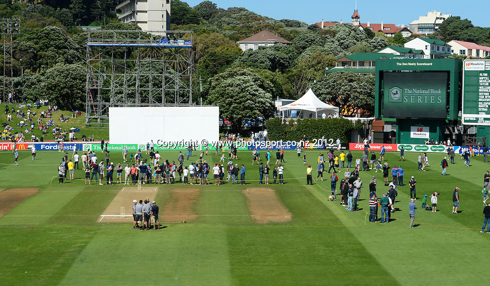 The crowd on the field at the lunch break. Test match cricket. Third Test, Day 3. New Zealand Black Caps versus South Africa Proteas, Basin Reserve, Wellington, New Zealand. Sunday 25 March 2012. Photo: Andrew Cornaga/Photosport.co.nz