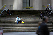 Manhattan, NY. Oct. 8, 2013. New Yorkers and tourists eat their lunches on the steps of Federal Hall, shuttered due to the government shutdown. 10082013. Photo by Nicholas Wells/NYCity Photo Wire.