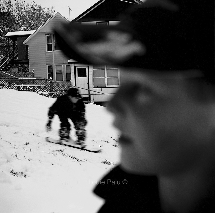 Boys snowboarding on a hill by Prospect Avenue, Cobalt, Ontario. From the book Cage Call: Life and Death in the Hard Rock Mining Belt. An in-depth project spanning over 12-years examining communities in one of the richest mining regions in the world located in Northwestern Ontario and Northeastern Quebec in Canada.