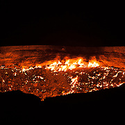 The flames of the burning gas in the Darvaza gas crater, often called The Gates of Hell, in the Karakum Desert, Turkmenistan