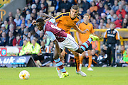 Idrissa Gueye gets away from Conor Coady during the Pre-Season Friendly match between Wolverhampton Wanderers and Aston Villa at Molineux, Wolverhampton, England on 28 July 2015. Photo by Alan Franklin.