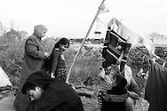 01 April 2016, Idomeni Greece - Mothers dressing and grooming their children.