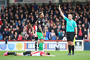 Bristol City midfielder, Marlon Pack (21) yellow card during the Sky Bet Championship match between Brentford and Bristol City at Griffin Park, London, England on 16 April 2016. Photo by Matthew Redman.