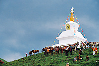 China, Hezhuo, 2005. A stupa rises high above Tibetans who came from all over Gansu to enjoy the two-day Hezhuo Cultural Festival.