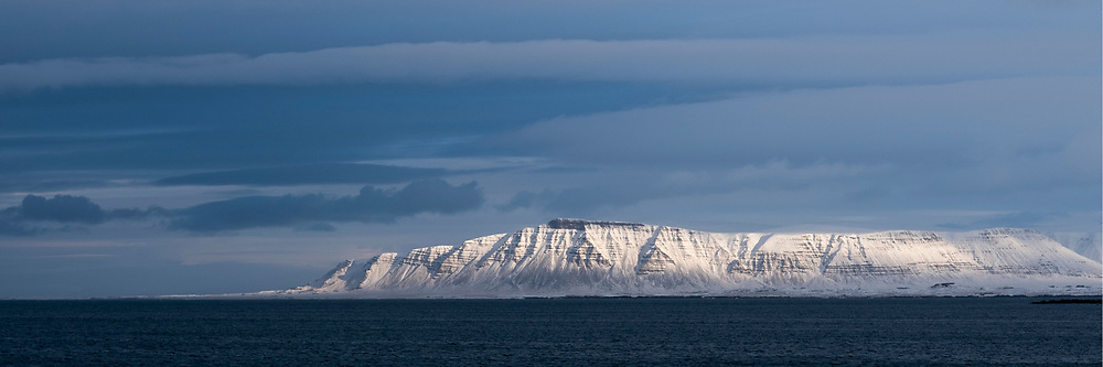 Light on snow cap in the distance, Snaefellness Peninsula, Iceland