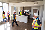 Visitors check out The Grad apartments and view of Downtown San Jose during SVBJ's BizMix presented by SWENSON at The Grad in Downtown San Jose, California, on July 31, 2019. (Stan Olszewski for Silicon Valley Business Journal)