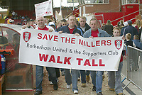 Photo: Aidan Ellis.<br /> Rotherham United v Bristol City. Coca Cola League 1. 25/03/2006.<br /> The Rotherham fans who walked from Rotherham to last weeks game at Huddersfield to raise money for their club, walk around Millmoor to the applause of other fans.