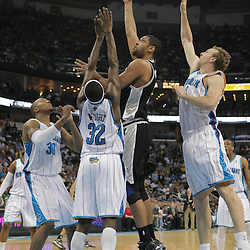 29 March 2009: San Antonio Spurs center Tim Duncan (21) shoots over New Orleans Hornets defenders Sean Marks (4), Julian Wright (32) and David West (30) during a 90-86 victory by the New Orleans Hornets over Southwestern Division rivals the San Antonio Spurs at the New Orleans Arena in New Orleans, Louisiana.