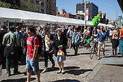 Corwds on the Bowery pass some exhibits at the Ideas City street festival. Many of the exhibits were in Sara D. Roosevelt Park, but two blocks of the Bowery and some side streets also featured exhibits.