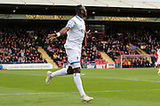 Ade Azeez of AFC Wimbledon celebrates after his opener during the Sky Bet League 2 match between York City and AFC Wimbledon at Bootham Crescent, York, England on 24 October 2015. Photo by Stuart Butcher.