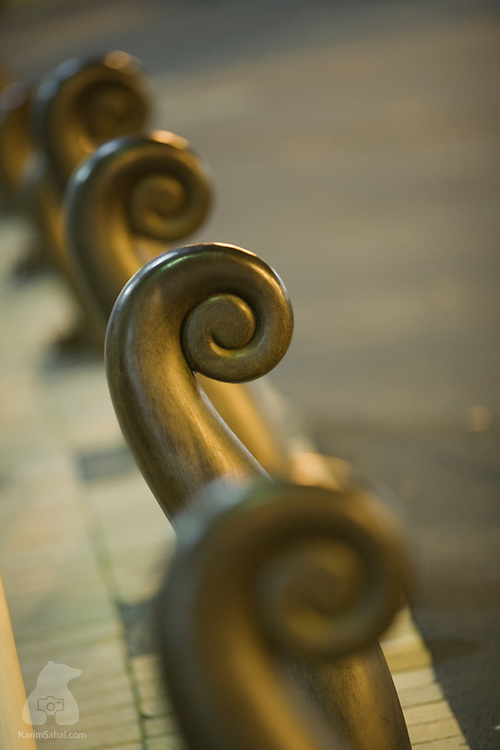 Row of bronze barriers shaped like fern fronds near Civic Square, Wellington, New Zealand.