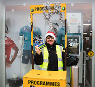 A programme seller outside of the stadium <br /> <br /> Photographer Simon King/Replay Images<br /> <br /> EPCR Champions Cup Round 4 - Ospreys v Northampton Saints - Sunday 17th December 2017 - Parc y Scarlets - Llanelli<br /> <br /> World Copyright &copy; 2017 Replay Images. All rights reserved. info@replayimages.co.uk - www.replayimages.co.uk