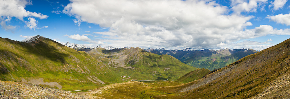Composite panorama of Talkeetna Mountains and alpine meadows of Hatcher Pass and Summit Lake State Recreation Site from cirque on April Bowl trail in Southcentral Alaska. Summer. Afternoon.