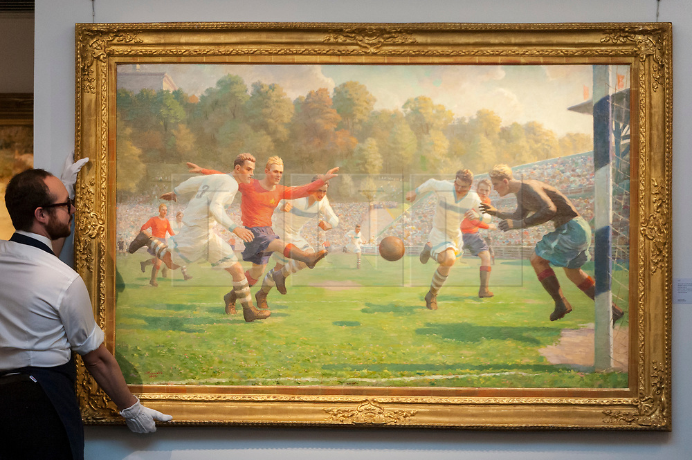 "© Licensed to London News Pictures. 01/06/2018. LONDON, UK. A Sotheby's technician presents ""Football Match"", 1949, by Andrei Vasilevich Korotkov (Est. GBP60-80k) at a preview of the Russian Pictures and Russian Works of Art, Fabergé & Icons sale which will take place at Sotheby's, New Bond Street on 5 June.  Photo credit: Stephen Chung/LNP"